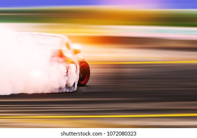 Blurred Race car drifting on speed track / Motosport