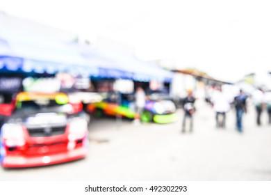 blurred racing auto motor racetrack speedway garage - blur background