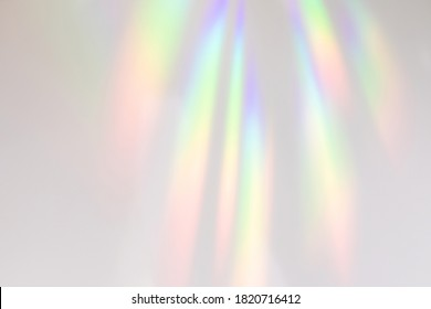 Blurred rainbow light refraction texture overlay effect for photo and mockups. Organic drop diagonal holographic flare on a white wall. Shadows for natural light effects - Shutterstock ID 1820716412