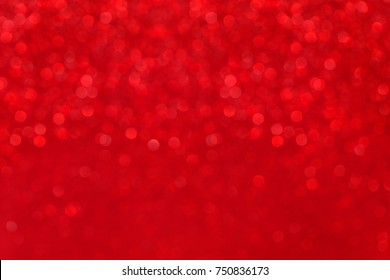 blurred red background with holiday bokeh, abstract