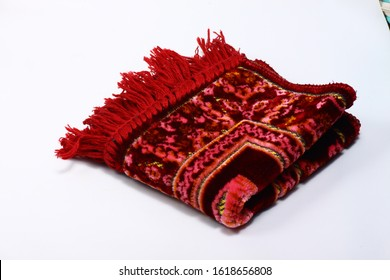 Blurred red praying rug on a white isolated background