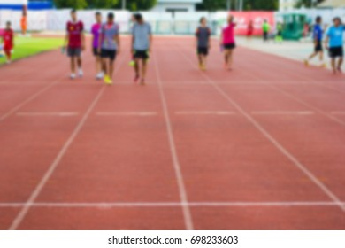 Blurred - Red running track in stadium and background  Athletes are practicing for fitness or competition - Exercise for good health