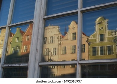 Blurred reflections of tenement houses in the windows on Długa Street, an unusual painting effect. Gdansk, Poland