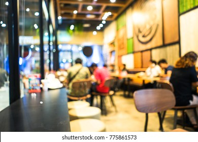 Blurred restaurant with bokeh light of people in fast food shop for background usage