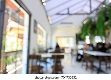 blurred restaurant cafe, white interior vintage contemporary modern style