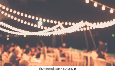 Blurred of restaurant view on night beach