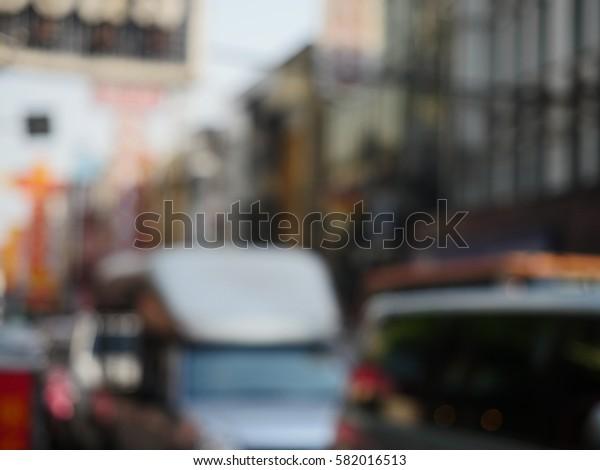 blurred road, car, building background. chinatown yaowarat road, bangkok, thailand.