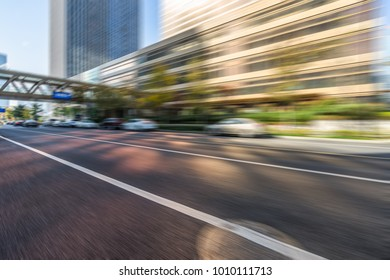 blurred road and modern office buildings