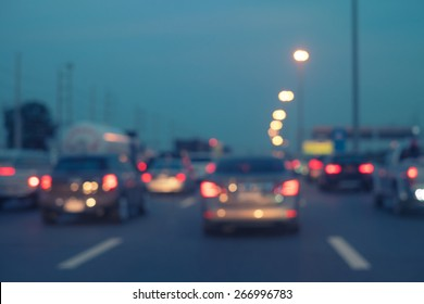 blurred road side with traffic jam and crowd car on street background. Template for transportation of going back home