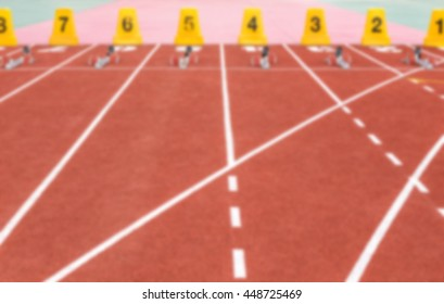 blurred running track with lane numbers in the stadium
