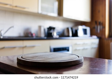 blurred rustic kitchen interior - focus on cutting board