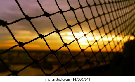 Blurred safety net at home and in the city, blur building background, sunset in Thailand