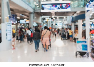 Blurred scene of airport terminal crowd with traveller and duty free shop in an airport in Bangkok, Thailand