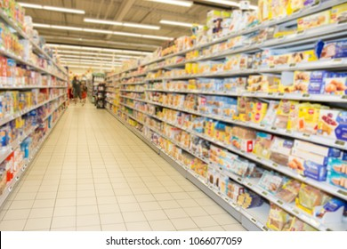 Blurred scene of alley shelf colorful grocery supermarket aisle