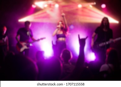 Blurred scene of a concert performance with light lit stage