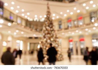 Blurred Scene with Customers around  Large Christmas Tree in Shopping Mall