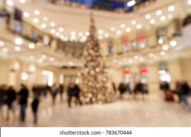 Blurred Scene with Customers in Shopping Mall during Christmas Time