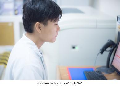 Blurred scientist working in biology laboratory white tone.