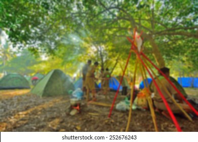 blurred scouts camping background.