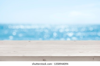 Blurred sea background with wood resort deck floor foreground