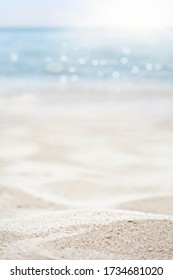 blurred of the sea and sand in the summer for abstract background