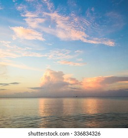 Blurred seascape with blue sky background on texture of paper