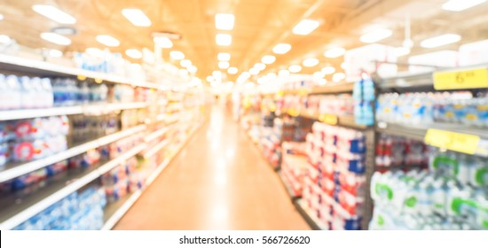 Blurred selection of canned foods, tuna, kosher foods, water, natural beverage, water filters on shelves in store at Humble, Texas, US. Defocused background variety product supermarket. Panorama style