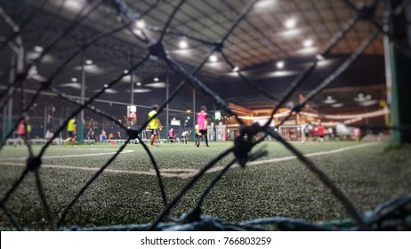 Blurred and selective focus of indoor soccer field on holiday at night time