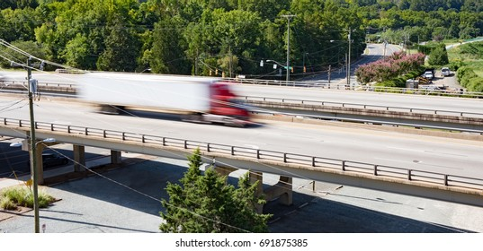 Blurred Semi-truck on a freeway to show motion.  (Slow shutter speed)