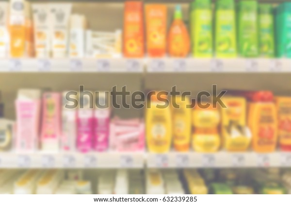 Blurred shelves with cosmetics hair styling products