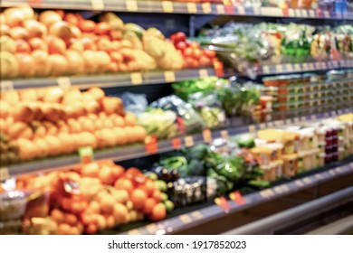 Blurred shelves with groceries in the supermarket.