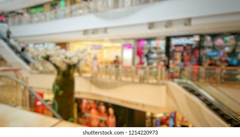 blurred shopping mall background. shopping center with people defocused background.