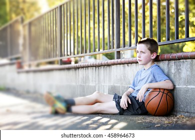 A blurred shot of an active kid with a basketball