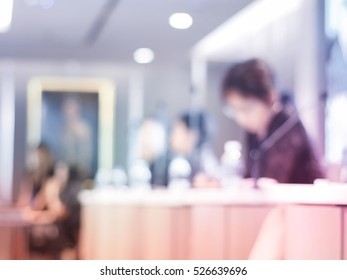 Blurred shot of unidentified lady with glasses in meeting room making business plan.