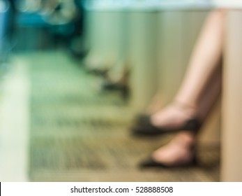 Blurred shot of woman's leg crossing in meeting room. Blurred shot of woman's legs in meeting room. Business conference. cross fade. colorful tone blurred background.