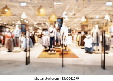 Blurred showcases fashion boutique with clothes.Big sales on Black Friday. On sale at a clothing store in a modern shopping mall. Mannequins in the shop window. Modern shopping mall