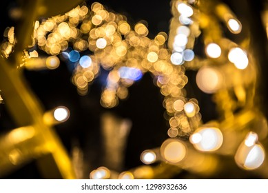 blurred silhouette and golden bokeh background