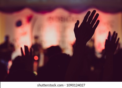 blurred, silhouette hands raising for religion background