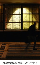 A blurred silhouette of a man that was returning home in the evening. Russia, Moscow, October 2016.