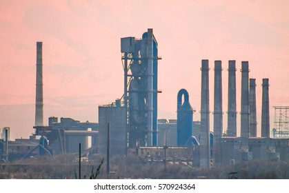 blurred silhouette of pipes in a haze plant -  blurred silhouette of factory chimneys