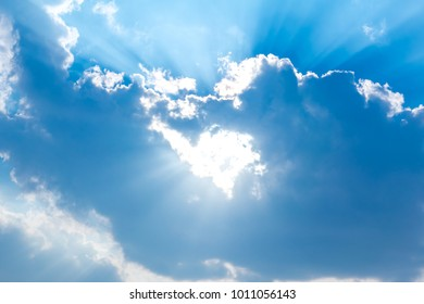 Blurred sky blue or azure sky and cloud. It beam of sun on cloud blue background