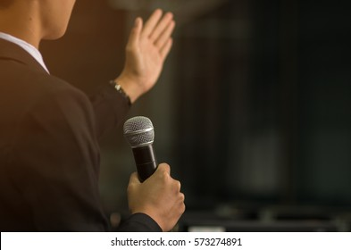 blurred of smart businessman speech, talking with microphone in conference hall, Seminar and Speaker Concept.