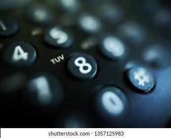 blurred snapshot of the phone's numeric keypad. push-button telephone. fragment. art toning