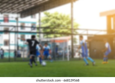Blurred Soccer ball field with match player background