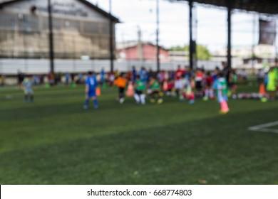 Blurred  soccer ball tactics on grass field