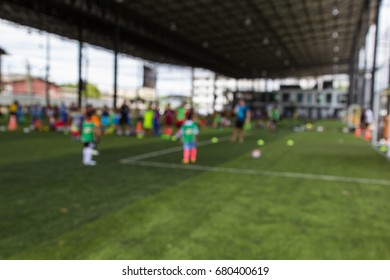 Blurred  soccer ball tactics on grass field with  for training thailand in  background Training children in Soccer academy