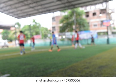 blurred soccer player