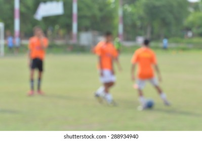 blurred soccer players on a soccer pitch