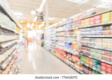 Blurred sodas, bottled teas, juices, protein, energy drinks aisle in store at Irving, Texas, US. Supermarket shelves variety of products display. Defocused background, bokeh light. Customer shopping