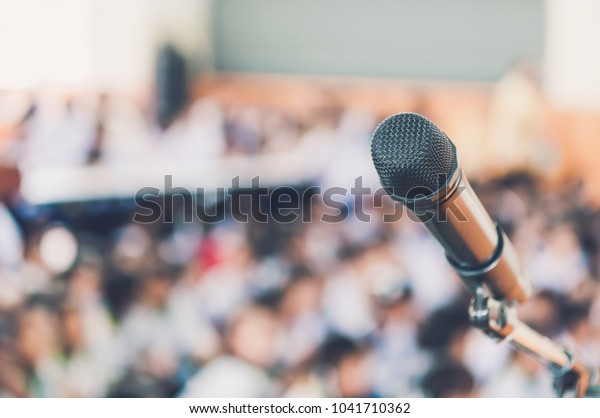 Blurred and Soft focus of head microphone on stage of Education meeting or event whit blurred background,Education meeting and event on stage concept and copy space